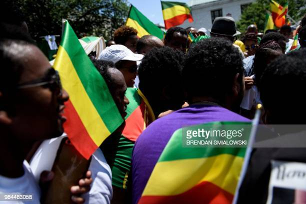 Supporters of Ethiopia's Prime Minister Abiy Ahmed rally for US support outside the State Department on June 26 2018 in Washington DC