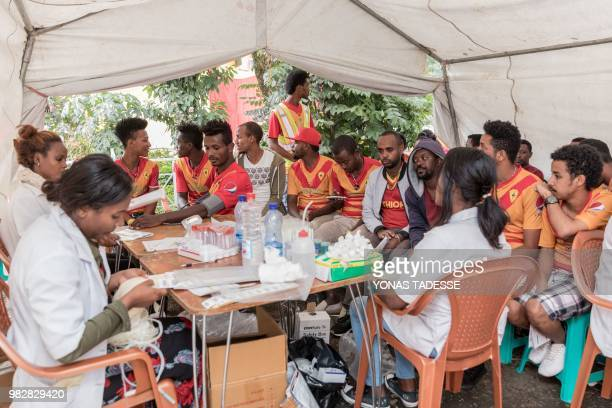Supporters of Ethiopia's St. George Football Club, one of Addis Ababa's largest football team, arrive to donate blood at Ethiopia Red Cross in Addis...