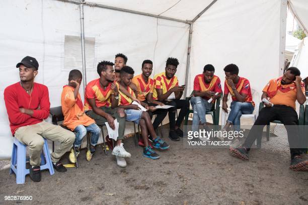 Supporters of Ethiopia's St. George Football Club, one of Addis Ababa's largest football team, wait to donate blood at Ethiopia Red Cross in Addis...