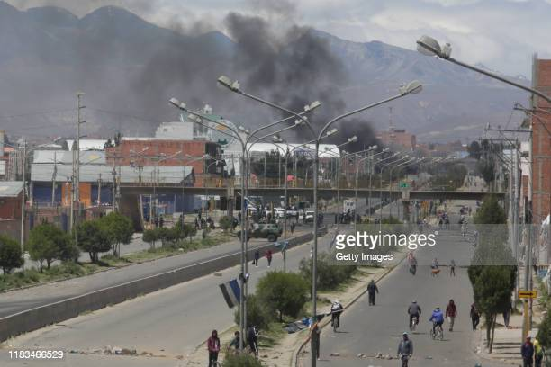 Supporters of Evo Morales Ayma block the road to a Yacimientos Petroliferos Fiscales Bolivianos oil refinery during protests on November 19, 2019 in...