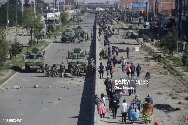 Supporters of Evo Morales block the road to the Senkata Fuel Plant as armed forces stand guard on November 20 2019 in El Alto outskirts of La Paz...
