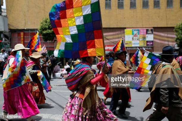 Supporters of Evo Morales march with Whipala flags during a protest on November 15 2019 in La Paz Bolivia Morales flew to Mexico alleging a coup...
