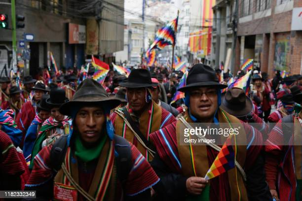 Supporters of Evo Morales wearing the traditional ponchos and holding Wiphala flags take part in a protest on November 14, 2019 in La Paz, Bolivia....