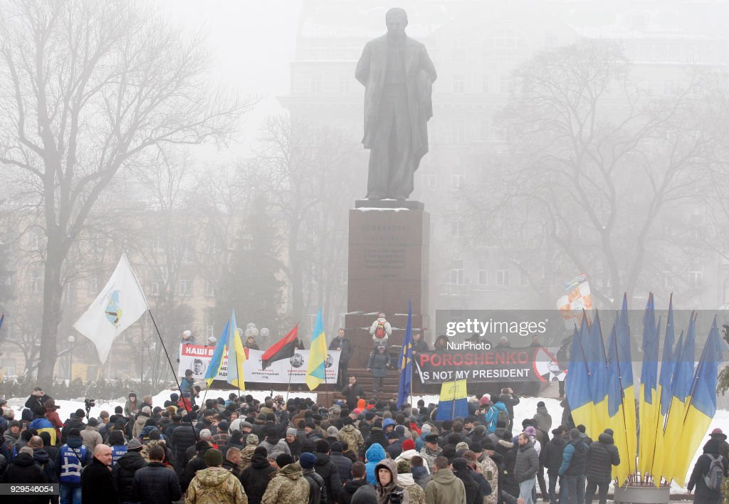Supporters of ex Georgian President Mikheil Saakashvili and activists from different nationalists parties holds a rally near the monument of Ukrainian poet Taras Shevchenko, in Kiev, Ukraine 9 March, 2018. Participants of the rally wait for a meeting with the Ukrainian president, who, as expected, to come to lay flowers at the monument Ukrainian poet Taras Shevchenko, on the occasion of the 204th anniversary of his birth.