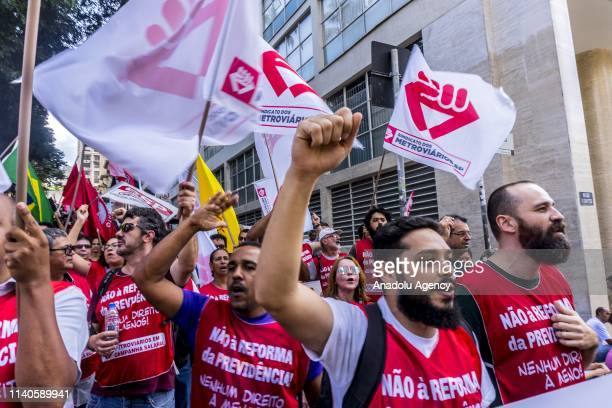 Supporters of ExBrazil president Lula take part in a demonstration to mark International Workers' Day in Sao Paulo Brazil on May 1 2019