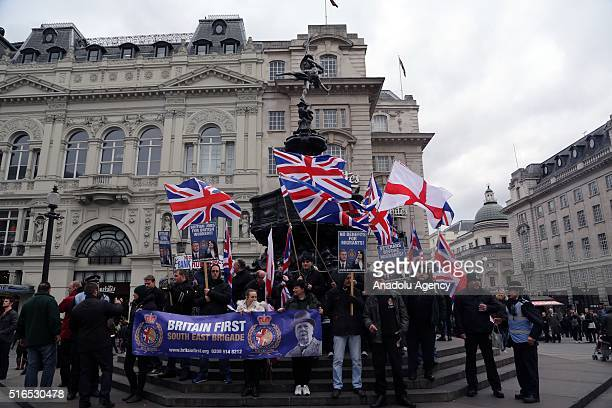 Supporters of extreme rightist 'Britain First' stage a protest against refugees at the Piccadily Circus in London England on March 19 2016 as others...