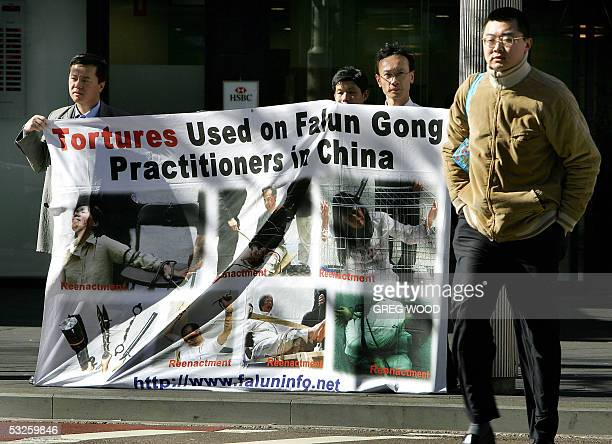 Supporters of Falun Gong display a banner near Chinatown in Sydney 20 July 2005 showing torture reenactments Today marks six years since the...