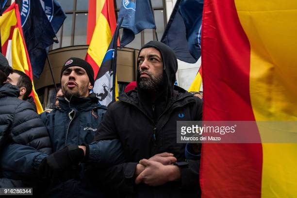 Supporters of far right group Hogar Social Madrid blocking the entrance of their occupied building as police arrives for their eviction which finally...