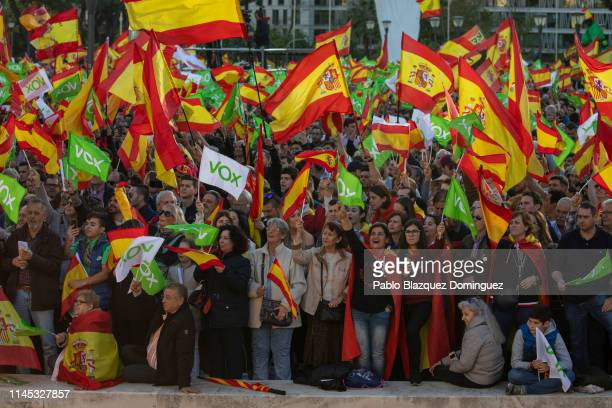Supporters of far right wing party VOX wave Spanish and Vox flags in the air during the VOX closing rally on April 26 2019 in Madrid Spain Spaniards...