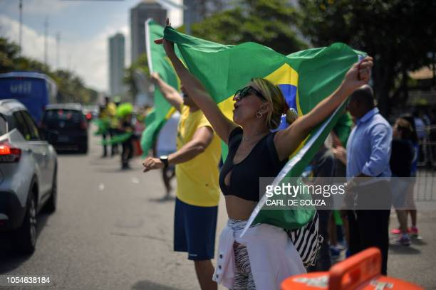 Supporters of farright lawmaker and presidential candidate for the Social Liberal Party Jair Bolsonaro are pictured in Rio de Janeiro Brazil during...