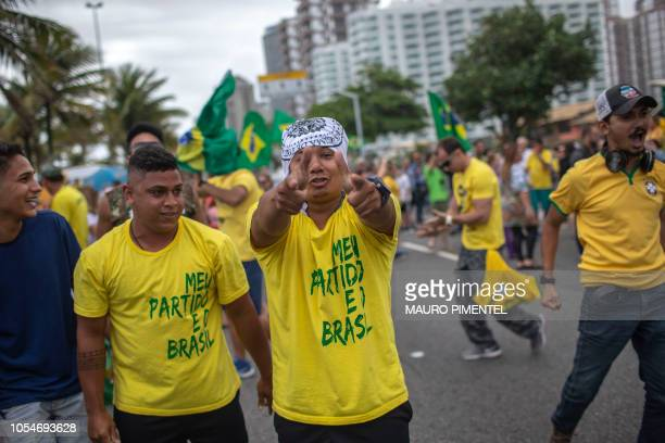 Supporters of farright lawmaker and presidential candidate for the Social Liberal Party Jair Bolsonaro take part in a proBolsonaro demonstration in...