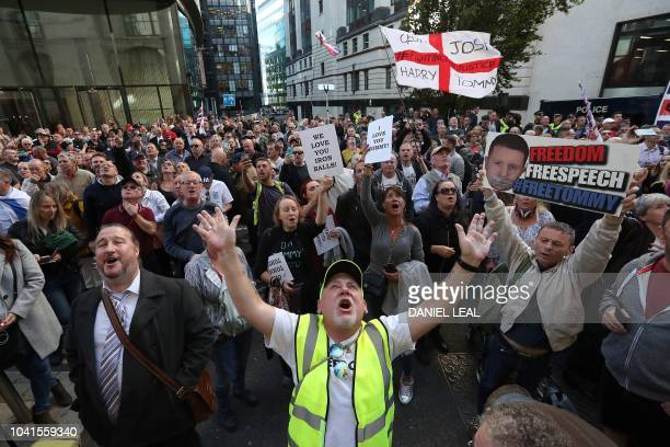Supporters of farright spokeseman Stephen Christopher YaxleyLennon AKA Tommy Robinson the former leader of the rightwing EDL demonstrate outside The...