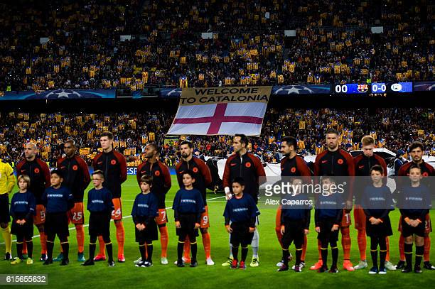 Supporters of FC Barcelona show proindependence of Catalonia flags while the teams enter the pitch before the UEFA Champions League group C match...