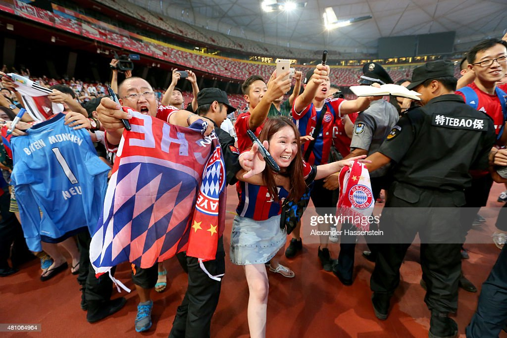 Supporters of FC Bayern Muenchen seen during a FC Bayern Muenchen training session at National Stadium at day 1 of the FC Bayern Audi China Summer Pre-Season Tour on July 17, 2015 in Beijing, China.