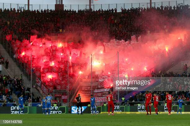 Supporters of FC Bayern Muenchen use pyrotechnics during the Bundesliga match between TSG 1899 Hoffenheim and FC Bayern Muenchen at PreZero-Arena on...