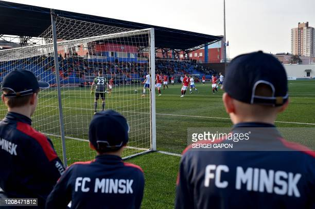 Supporters of FC Minsk attend the Belarus Championship football match between FC Minsk and FC DinamoMinsk in Minsk on March 28 2020 Belarus continue...