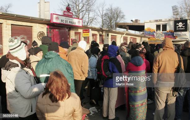 Supporters of FC.St.Pauli wait in front of the ticket centre during the sale of tickets for the German Cup match between FC St.Pauli and Werder...