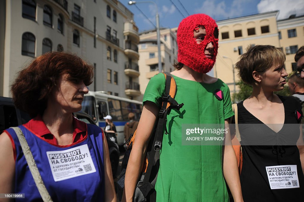 Supporters of feminist punk band pussy riot wear the groups trademark coloured balaclava and