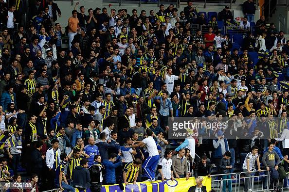 Supporters of Fenerbahce Ulker Istanbul cheer during the ...