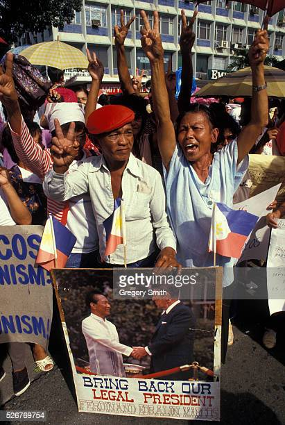 Supporters of Ferdinand Marcos at a political rally during the presidential campaign against Aquino