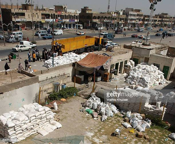 Supporters of firebrand Shiite cleric Moqtada alSadr unload food ration supplies donated by Sadr city residents to the people of northern town of...