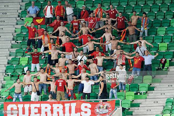 Supporters of FK Partizani are hand in hand during the UEFA Champions League Qualifying Round match between Ferencvarosi TC and FK Partizani at...