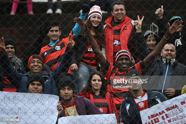 Supporters of Flamengo cheer their team during a match between Flamengo and Internacional as part of the Brazilian Serie A championship at Centenario...