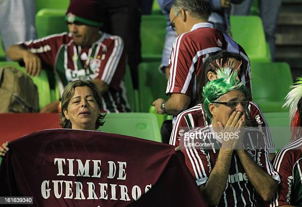 Supporters of Fluminense support their team during a game between Fluminense FC and Caracas as part of the Copa Bridgestone Libertadores 2013 at the...