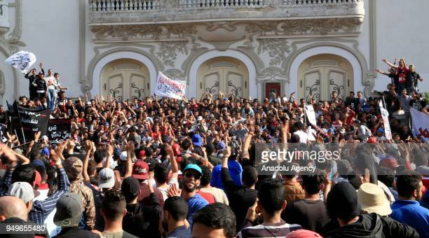 Supporters of Football Club Africain stage a protest after the death of a supporter Omar Abidi as they march from the club's facility to Municipal...