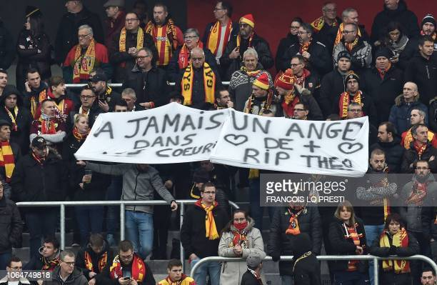 Supporters of football club RC Lens hold a banner reading 'Forever an angel in our hearts' for Theo Hallez, a 14-year-old teenager who was found dead...