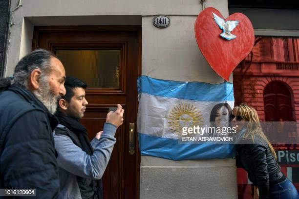 Supporters of former Argentine president Cristina Kirchner wait outside her appartment in Buenos Aires on August 13 2018 Kirchner appeared before...