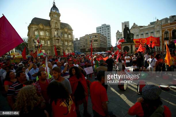 Supporters of former Brazilian president Luis Inacio Lula da Silva take part in a demonstration in his favor at Generoso Marques Square in Curitiba...