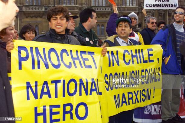 Supporters of former Chilean dictator Augusto Pinochet rally at Parliament Square 18 January as Britain's highest court begins a fresh hearing to...