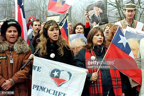 Supporters of former Chilean dictator Augusto Pinochet rally for his release outside the Wentworth estate 21 January where the general and his family...