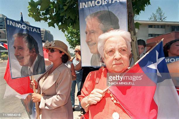 Supporters of former Chilean dictator Gen Augusto Pinochet rally with Chilean flags and Pinochet portraits near the diplomatic compounds of Great...