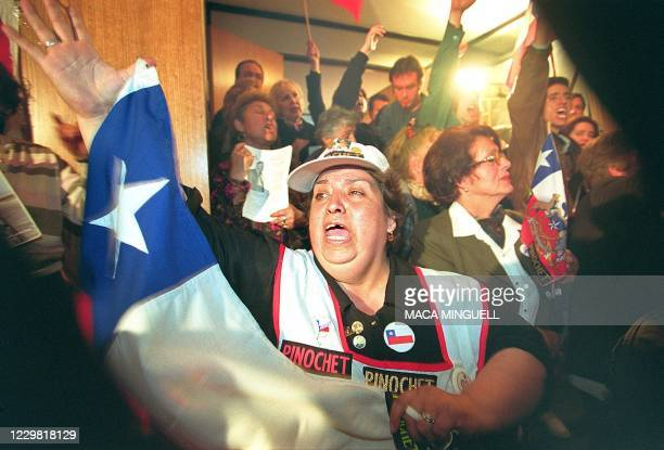 Supporters of former Chilean dictator Gen. Augusto Pinochet react in anger to the announcement by London Bow Street magistrate's court that it was...