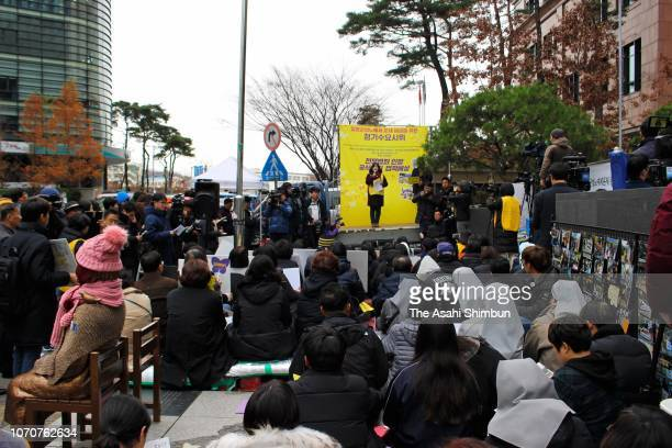 Supporters of former comfort women stage a weekly rally near the statue of a girl representing the sufferings of comfort women in the vicinity of the...