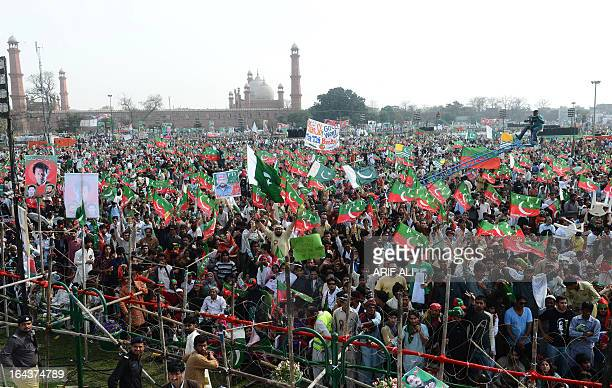 Supporters of former cricketer and chairman of Pakistan's political party Pakistan Tehreek-e-Insaf, Imran Khan, gather during a public meeting in...