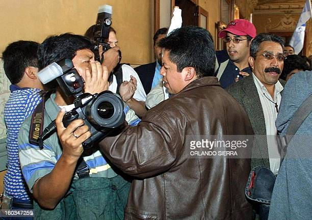 Supporters of former dictator accused of genocide Efrain Rios Montt attack press photographers while their leader was signing his official...