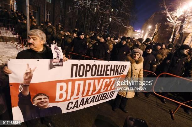 Supporters of former Georgian President Mikheil Saakashvili demonstrate holding a banner reading 'Poroshenko is not our president' in front of the...