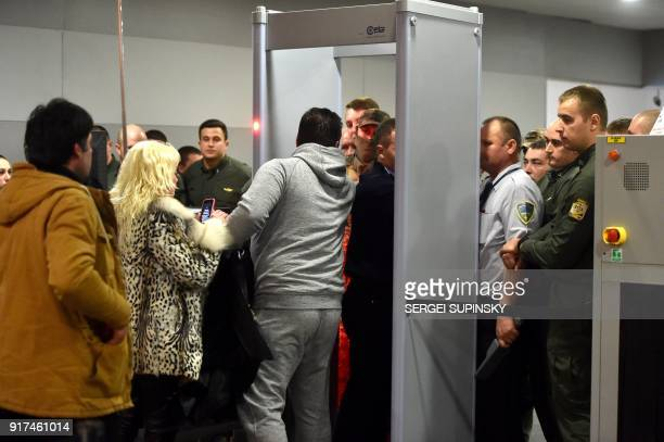 Supporters of former Georgian President Mikheil Saakashvili try to pass through security and the border control at Boryspil International Airport in...