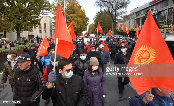Supporters of former Kyrgyzstan President Almazbek Atambayev attend a rally in Bishkek on October 9 2020 Two large crowds supporting rival...