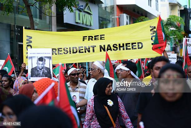 Supporters of former Maldives president Mohamed Nasheed protest against the detention of the former president on terror charges in Male on February...