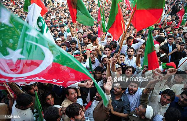 Supporters of former Pakistani cricketerturned politician Imran Khan attend a public meeting in Peshawar on November 25 2011 Thousands attended the...