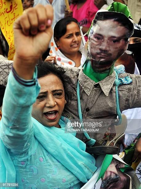 Supporters of former Pakistani premier Nawaz Sharif's Pakistan Muslim League-Nawaz party burn an effigy of former president Pervez Musharraf during a...