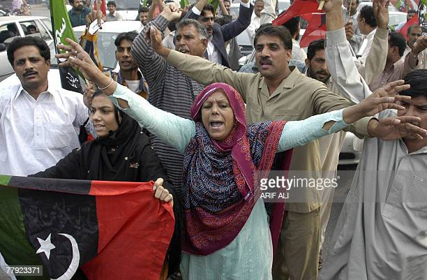 Supporters of former Pakistani prime minister Benazir Bhutto shout antiMusharraf slogans during a demonstration in Lahore 15 November 2007 Pakistani...
