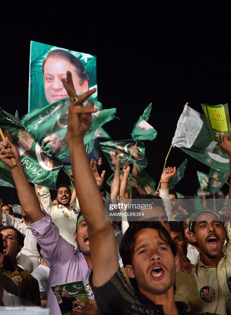 Supporters of former Pakistani Prime Minister Nawaz Sharif shout slogans during an election campaign meeting in Rawalpindi on May 7, 2013. The election will mark a democratic milestone in a country ruled for half its history by the military. It will be the first time that a civilian government has served a full term and handed over to another at the ballot box.