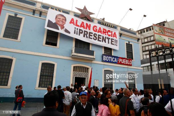 Supporters of former Peruvian president Alan Garcia gather for his funeral in APRA headquarter at Casa del Pueblo on April 17 2019 in Lima Peru Alan...
