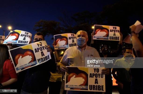 Supporters of former President and Senator Alvaro Uribe Velez hold banners that reads in spanish I stand with Uribe during a protest against the...