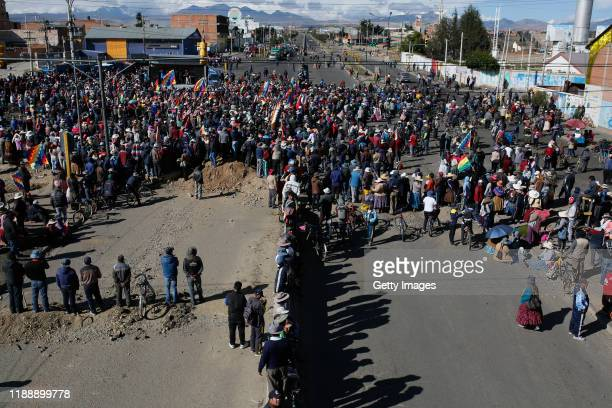 Supporters of former president Evo Morales block a road to a Yacimientos Petroliferos Fiscales Bolivianos oil refinery as part of a protest against...